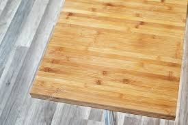 big wooden cutting board on the table in kitchen photo by manuku