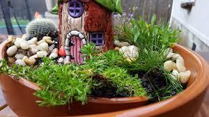 a closeup of the fairy house in its broken pot garden photo by j j