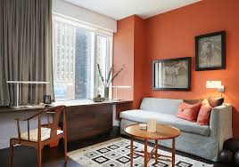 home office it. it is drapes and a space savvy couch that bring gray to this home office in