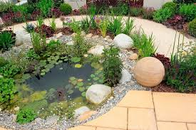 A small pond is a great accompaniment to a rock garden. Rocks look perfect  around