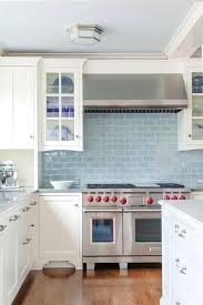 light blue and white kitchen cabinets white kitchen cabinets with blue glazed subway tiles light blue