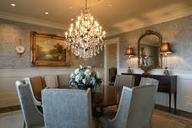 elegant furniture and lighting. elegant dining room with parsons chairs and round table under the grandeur crystal chandelier furniture lighting