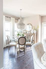 gray wood bead chandelier over dining table