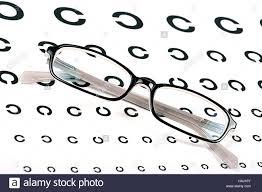 Black Glasses On A Eye Sight Test Chart Stock Photo