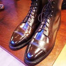two cordovan boots above and below with two very diffe creasing patterns
