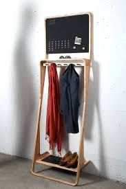 shoe and coat racks leaning loop is a modular clothing hanger and shelf with magnetic chalkboard