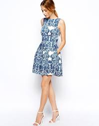 appropriate dress for wedding. skater dress in baroque print ($92): plain white dresses may not be appropriate to wear a wedding, but this blue pattern makes one welcome for wedding