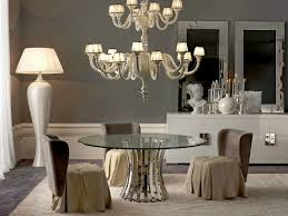 empire round glass dining table and chandelier over