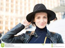 woman in black hat smile on srs in paris france fashion beauty look makeup fashion accessory style sensual woman with brunette hair