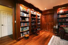 Custom library bookcases with hidden compartments traditional-home-office