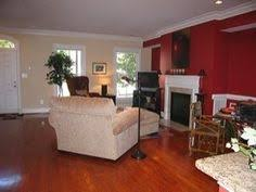 living room ideas with red accent wall. red accent wall in living room with black frames on walls. ideas