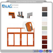 wood grain and powder coating aluminium left and right folding and sliding door system with interior and exterior type