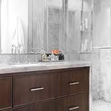 dark brown vanity with waterfall edge countertop