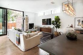 view in gallery transitional living room with plenty of natural light design steele street studios