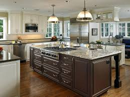white kitchen cabinets with brown granite sapphire brown granite kitchen traditional with white cabinetry hammered bar