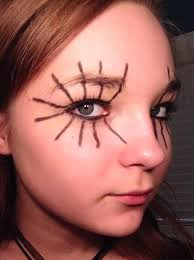 create a dark smokey eye with tons of dark eyeliner this is the center of your web