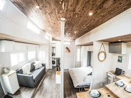 tiny houses. The Aurora From Canadian Builder ZeroSquared Is An Expandable Tiny House With Two Motorized Pop-out Rooms That Create Over 374 Square Feet Of Living And Houses