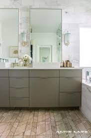 taupe bath vanity cabinets with white marble wall tiles