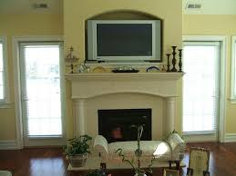 decor over fireplace living room with tv over fireplace mantels mantel and