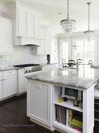 view full size stunning white kitchen features a pair of pottery barn clarissa glass drop small round chandeliers