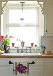 lighting over kitchen sink. over kitchen sink lighting ideas