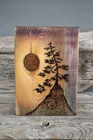 done with a wood burner and a piece of wood with a beautiful knot artistic wood pieces design