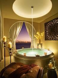 beautiful circle bathtub with brown seat