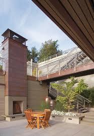 metal outdoor fireplace patio contemporary with stone fireplace outdoor wood chairs outdoor fireplace
