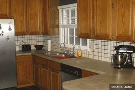 painted brown kitchen cabinets before and after. Wood Cabinets Painted White Tile Backsplash Brown Kitchen Before And After