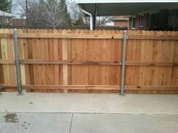 installing wood fence posts can new wood fence go over a raised concrete slab community a installing wood fence posts post anchor fence on concrete how