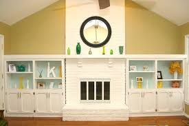 dramatic results of a white painted brick fireplace