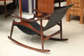 brazilian a rare sergio rodrigues rosewood and leather rocking chair for