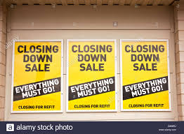 Sales Closure Closing Down Sales Signs On The Wall Outside A Shop Smaller Print