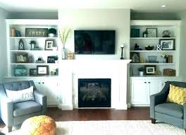 great cabinets around fireplace built office supplies and shelves beside