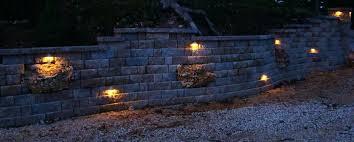 retaining wall lights stone lighting cinder block fence google search courtyard walls under capstone