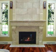interior white stone fireplace with white mantel on laminate flooring between double glass windows on