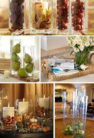 Ways-to-Decorate-And-Style-Clear-Glass-Vases--I like the sticks with the  apples, thinking of pine cones and white sticks for winter.