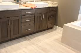 vinyl bathroom flooring. Luxury Vinyl Plank Flooring With Dark Shaker Cabinets In Bathroom - Degraaf Interiors