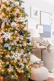 A navy and gold Christmas tree adds a touch of understated luxury to this  modern farmhouse