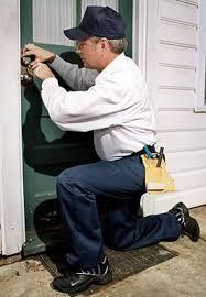 locksmith working. Locksmith Working On A Door