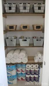 bathroom closet ideas. Linen Closet Organization (and The End Of My Pink Walls!) Bathroom Ideas R