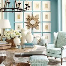 this bright aqua living room is balanced with stunning white decor for a fresh and colorful