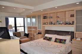 Superb Bedroom Wall Units Surrounds Bed With Custom Built Ins