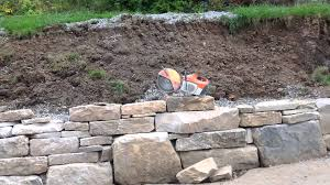 how to build a rock retaining wall with mortar dry stack stone cost cement round stones
