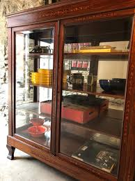 Hexagon shaped corner display cabinet, with aluminum extrusions and black laminate base. Antique Fench Glass China Cabinet Antique Glass Bookshelf French Antique Curio Cabinet By Vintadelphia From Vintadelphia Of Germantown Philadelphia Attic