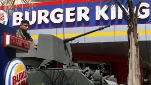 Image result for A Lebanese army soldier sits on his armored personnel carrier, as he stands guard outside the Burger King PHOTO