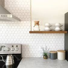 black and white kitchen with an elegant marble hexx tile backsplash