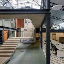 interior designs for office. Offices In A Converted Warehouse Centre Around Suspended Concrete Staircase Interior Designs For Office T