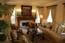 tropical living rooms: tropical living room design idea with potted plants plus nice fireplace and long sofa also glass