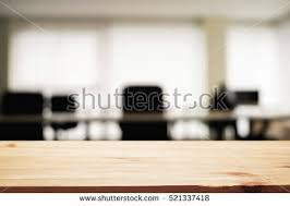 office desk space. Empty Wooden Desk Space Over Blurred Office Or Meeting Room Background. Product Display.
